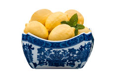 Bowl of Lemons. A Blue and White Asian Bowl with Lemons and Mint royalty free stock photography