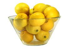 Bowl of Lemons. Glass bowl filled with juice yellow lemons Royalty Free Stock Photography
