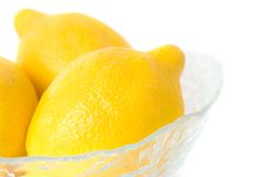 Bowl of Lemons, Isolated. Three lemons in a glass bowl Stock Photography