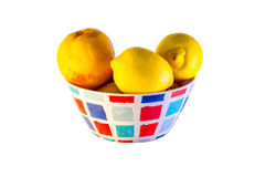 Bowl with lemons and peach. Isolated in a white background Royalty Free Stock Photography