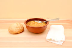 Bowl of lentil soup with a bread roll Stock Image