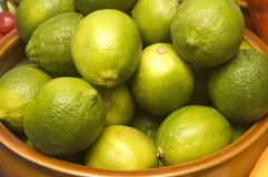 Bowl of limes Stock Photos