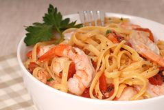 A bowl of linguine with shrimp Stock Image