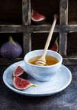 Honey and cut fresh figs Royalty Free Stock Photo