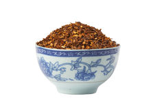 Bowl of loose Rooibos red tea, isolated. Blue bowl of loose dry Rooibos red tea, isolated on white background Stock Images