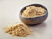 Bowl of maca powder Royalty Free Stock Images