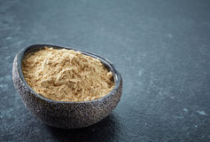Bowl of maca powder Stock Image