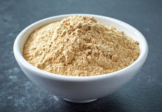 Bowl of maca powder Stock Photography