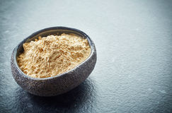 Bowl of maca powder Stock Photos