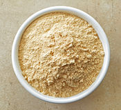 Bowl of maca powder Royalty Free Stock Photography