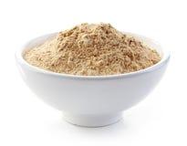 Bowl of maca powder royalty free stock photography