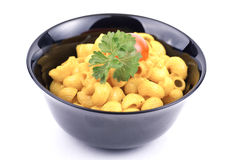 A bowl of macaroni. With parsley and  tomato Stock Photo