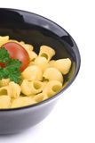 Bowl of macaroni. With parsley and  tomato Royalty Free Stock Photography