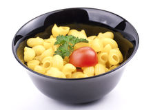 Bowl of macaroni. With parsley and  tomato Royalty Free Stock Image