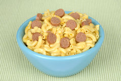 Bowl of macaroni and cheese with hotdog slices Royalty Free Stock Photo
