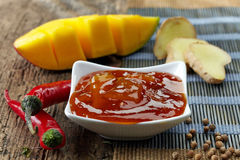 Bowl of Mango Chutney. On old wooden table Stock Photography