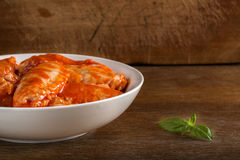 Bowl with marinated chicken wings and copy space. Bowl with marinated chicken wings over wooden background and copy space Royalty Free Stock Photo