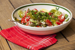 Bowl of Marinated Greek Salad with Red Napkin Stock Photography