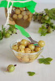Bowl with marinated green gooseberries Stock Photo