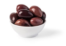 Bowl of marinated kalamata olives. Isolated on white. with clipping path Stock Images