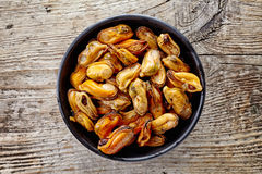 Bowl of marinated mussels, from above stock photography