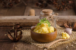 bowl of mash potato on wooden table Stock Photos