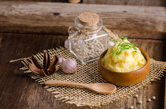 bowl of mash potato on wooden table Stock Images