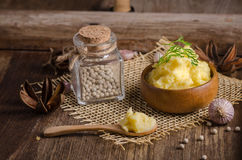 bowl of mash potato on wooden table Royalty Free Stock Images