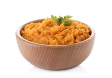Bowl with mashed sweet potatoes on white. Background stock photo