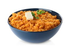 Bowl with mashed sweet potatoes on white. Background royalty free stock photo