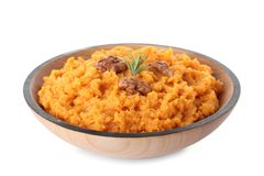 Bowl with mashed sweet potatoes. On white background stock image