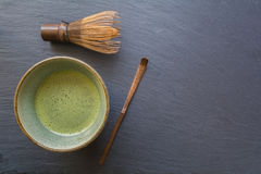 Bowl of Matcha on Black background. Bowl of Matcha with a Chasen and a Chashaku royalty free stock photos
