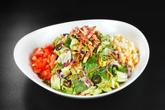 Bowl of Meat Salad. With eggs, tomatoes, fried ham, salad, cabbage and olives Royalty Free Stock Photo