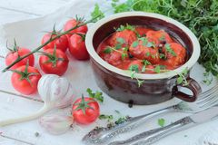 Bowl with meatballs in tomato sauce Stock Image