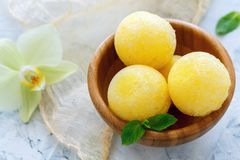 Balls of melon sorbet in a wooden bowl. Royalty Free Stock Image