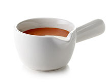 Bowl of melted caramel sauce Stock Image