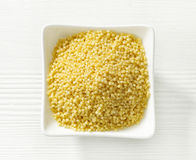 Bowl of millet grains Royalty Free Stock Images