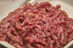 Minced bovine crane for food production. Bowl of minced beef in macro shot, ready to be used in the kitchen for some creative recipe Stock Photo