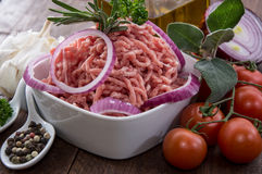 Bowl with Minced Meat on wood. En background Stock Photos