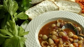 Bowl of Minestone Soup and Bread. Royalty Free Stock Image