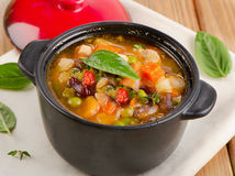 Bowl of minestrone soup  with beans and vegetables. Stock Images