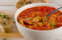 Bowl of minestrone soup with bread Stock Photography