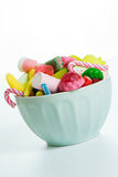 Bowl mixed colorful candy on withe background, kids holidays Stock Images