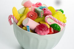 Bowl mixed colorful candy on withe background, kids holidays Royalty Free Stock Images