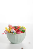 Bowl mixed colorful candy on withe background, kids holidays Royalty Free Stock Photos
