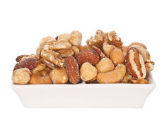 Bowl of Mixed Nuts. Isolated on white Royalty Free Stock Photography