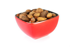 Bowl of mixed nuts containing almonds, hazelnuts, walnuts and Br. Azil nuts on a white background Stock Photos