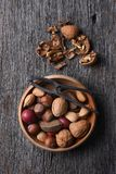 Bowl of Mixed Nuts and Nutcracker Stock Photography