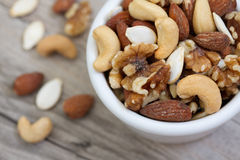 Bowl of Mixed Nuts. On rustic wooden table in natural light royalty free stock photos