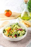 Bowl of mixed salad. On complex background Royalty Free Stock Photos